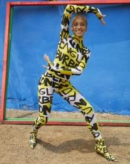 Adwoa Aboah in a graffiti-print bodysuit and leggings c Courtesy of Burberry_Juergen Teller