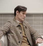 Matt Smith wears a check car coat with a cashmere cable-knit sweater . photo © Burberry