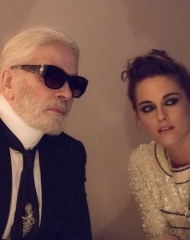 Kristen Stewart and Karl Lagerfeld at the Vanity Fair France and Chanel Dinner .