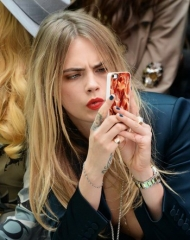 Cara Delevingne wearing Burberry AW14 Teal Blue nail varnish on the front row of the Burberry Prorsum Spring_Summer 2015 Show