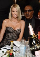 Paige Butcher in Oscar De La Renta Resort 2020 and Eddie Murphy
