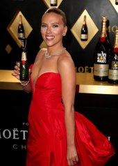 Scarlett Johansson wore a plunging red gown by Vera Wang