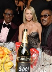 Wesley Snipes, Paige Butcher in Oscar De La Renta Resort 2020 and Eddie Murphy