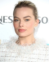Margot Robbie in Chanel . EE British Academy Film Awards Nominees Party ph. by Mike Marsland)