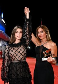 Anamaria Vartolomei and Audrey Diwan - Celebrities wearing Chanel during the closing ceremony of the 78th Venice International Film Festival . photo by Pascal Le Segretain