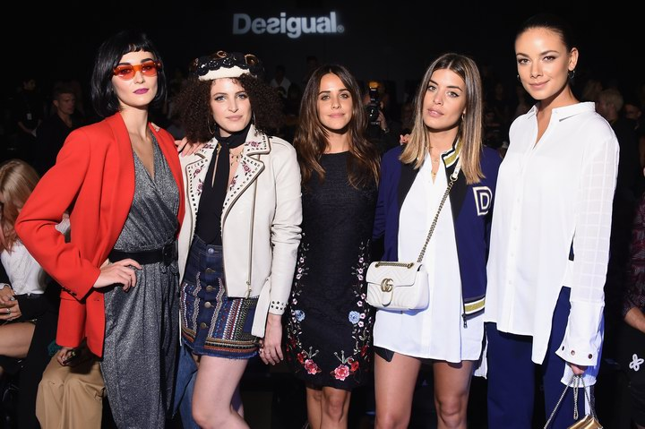 Armela Jakova, Marienne Mirage, Macarena García, Aida Domenech (Dulceida) and Yanina Ushe wearing Desigual clothing pose at Desigual fashion show during New York Fashion Week (Photo by Michael Loccisano/Getty Images For Desigual)