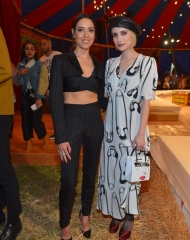 Aubrey Plaza; Emma Roberts - BURBANK, CA - JUNE 08: Aubrey Plaza (L) and Emma Roberts attends the Moschino Spring/Summer 19 Menswear and Women's Resort Collection at Los Angeles Equestrian Center on June 8, 2018 in Burbank, California.  (Photo by Donato Sardella/Getty Images for Moschino)