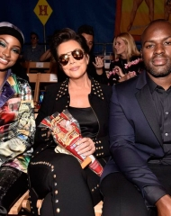 BURBANK, CA - JUNE 08:  (L-R) Justine Skye, Kris Jenner, and Corey Gamble attend the Moschino Spring/Summer 19 Menswear and Women's Resort Collection at Los Angeles Equestrian Center on June 8, 2018 in Burbank, California.  (Photo by Frazer Harrison/Getty Images for Moschino )