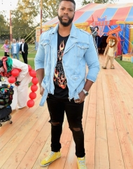 Winston Duke attends the Moschino Spring/Summer 19 Menswear and Women's Resort Collection at Los Angeles Equestrian Center on June 8, 2018 in Burbank, California.