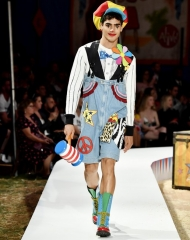 A model walks the runway during the Moschino Spring/Summer 19 Menswear and Women's Resort Collection at Los Angeles Equestrian Center on June 8, 2018 in Burbank, California.
