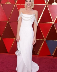 Margot Robbie in Chanel .  90th Academy Awards  (photo by Kevork Djansezian)