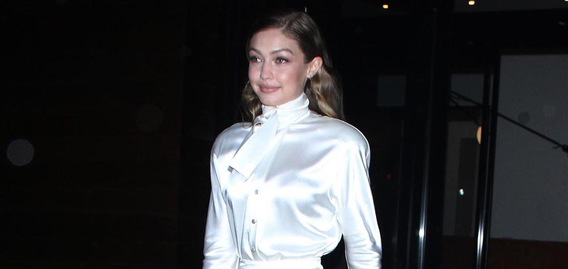 Gigi Hadid wears a dress by Andreas Kronthaler X Vivienne Westwood Bridal