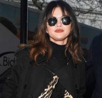 Selena Gomez wearing Burberry in London (photo by Beretta/Sims/Shutterstock;)