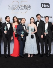 Joel Johnstone, Caroline Aaron, Michael Zegen, Marin Hinkle, Kevin Pollak, Rachel Brosnahan, Luke Kirby, Brian Tarantina, Tony Shalhoub, and Zachary Levi pose in the press room with awards for Outstanding Performance by an Ensemble in a Comedy Series in The Marvelous Mrs. Maisel during the 25th Annual Screen Actors Guild Awards at The Shrine Auditorium on January 27, 2019 in Los Angeles, California. 480645  (Photo by Gregg DeGuire/Getty Images for Turner)